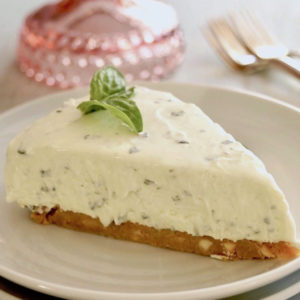 One slice of Sweet Basil Cheesecake with Lemon Crust on white plate