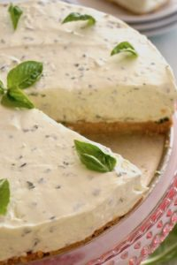 Sweet Basil Cheesecake with Lemon Crust with one slice cut out