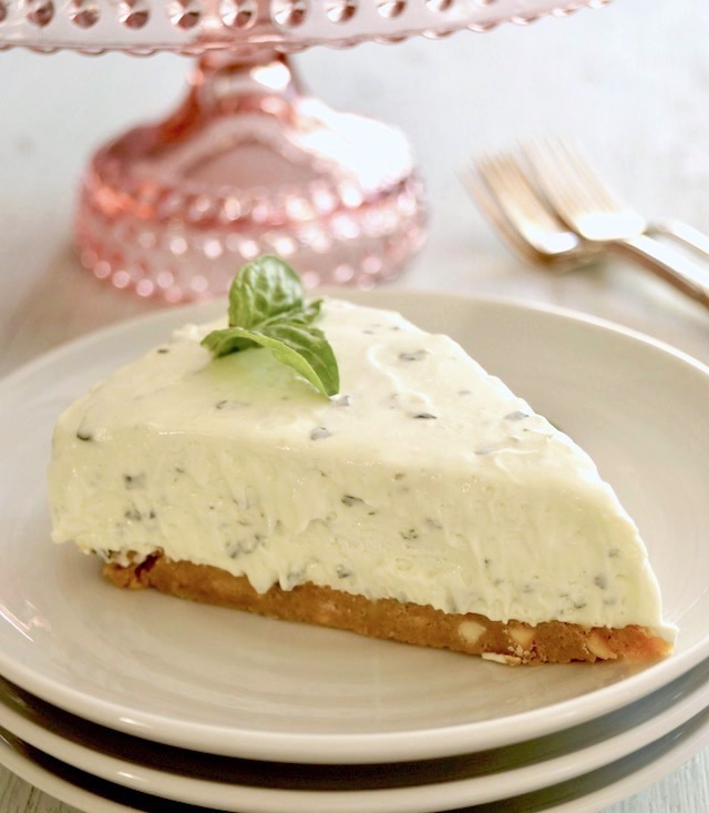 one slice of basil cheesecake on white plate