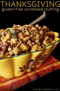 Gluten-Free Cornbread Stuffing in a yellow ceramic Italian dish with silver serving spoon
