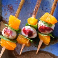 Citrus Caprese Kebabs with tangerines on a blue, creamic plate