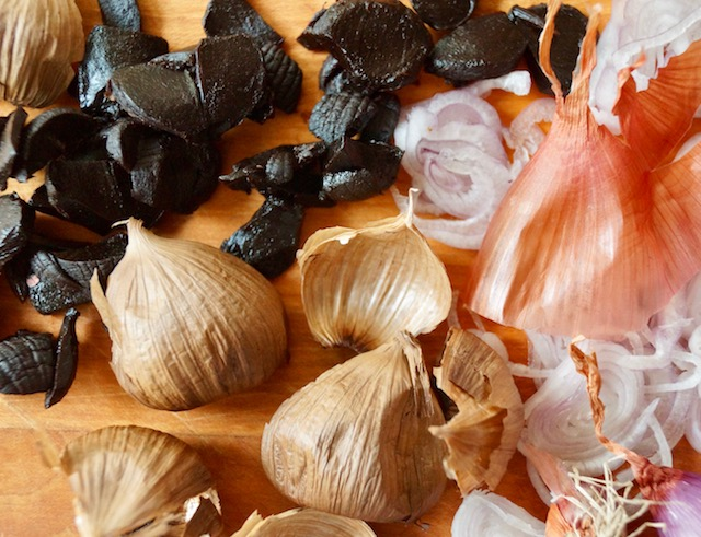 roughly chopped black garlic and shallots with skins