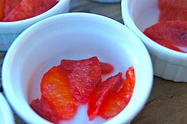 a few blood orange segments in a white bowl