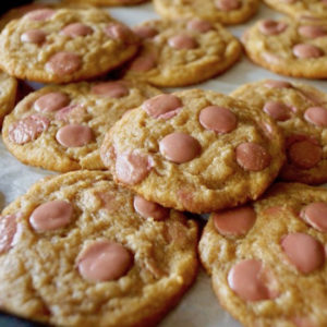 several ruby chocolate chip cookies on sheet pan