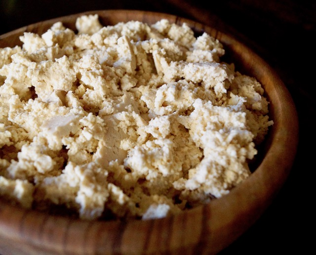 wooden bowl filled with crumbled tofu