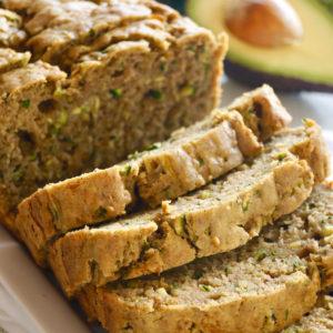 sliced loaf of avocado zucchini bread