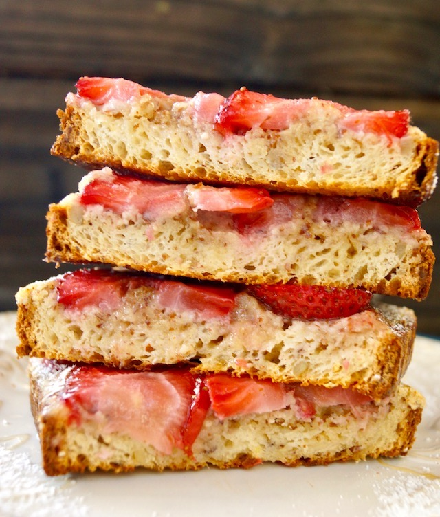 four pieces fo Frangipane toast with strawberries in a stack