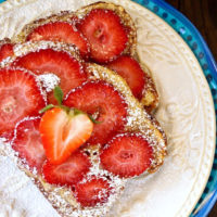 two slices of Strawberry Frangipane Toast esn white and blue plates