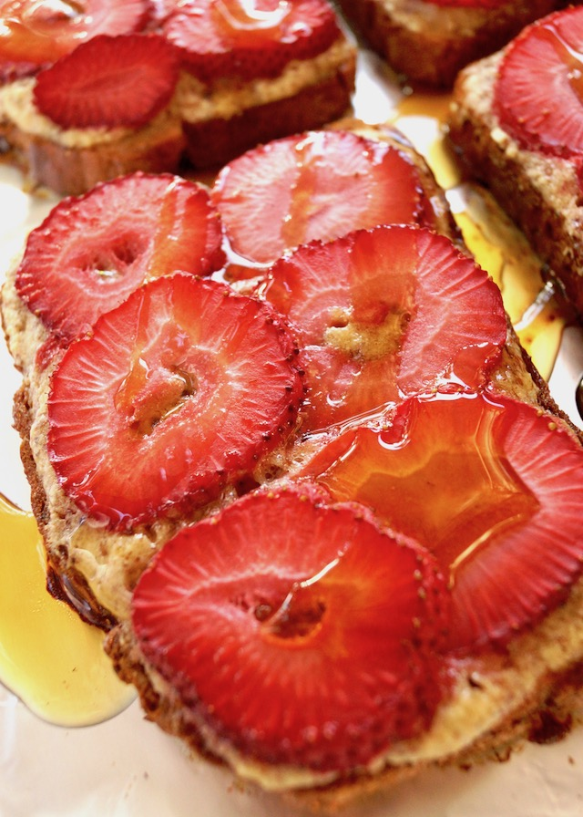 cose up of Strawberry Frangipane Toast with syrup drizzled over it