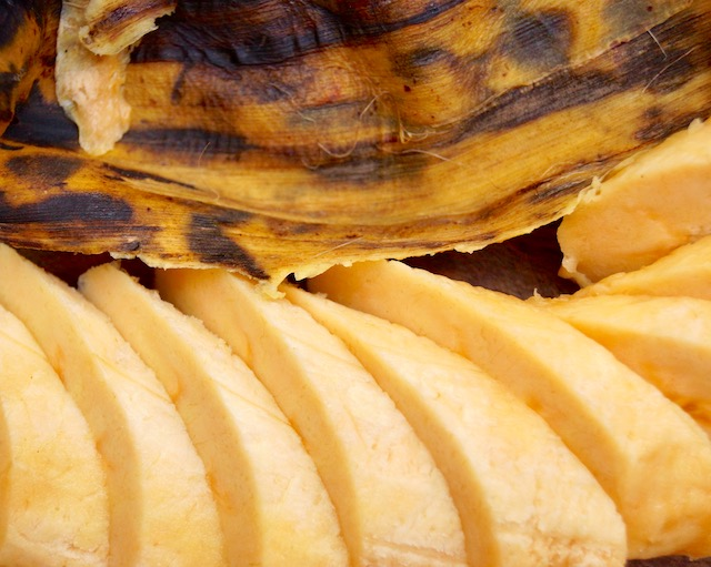 sliced plantain with skin next to it