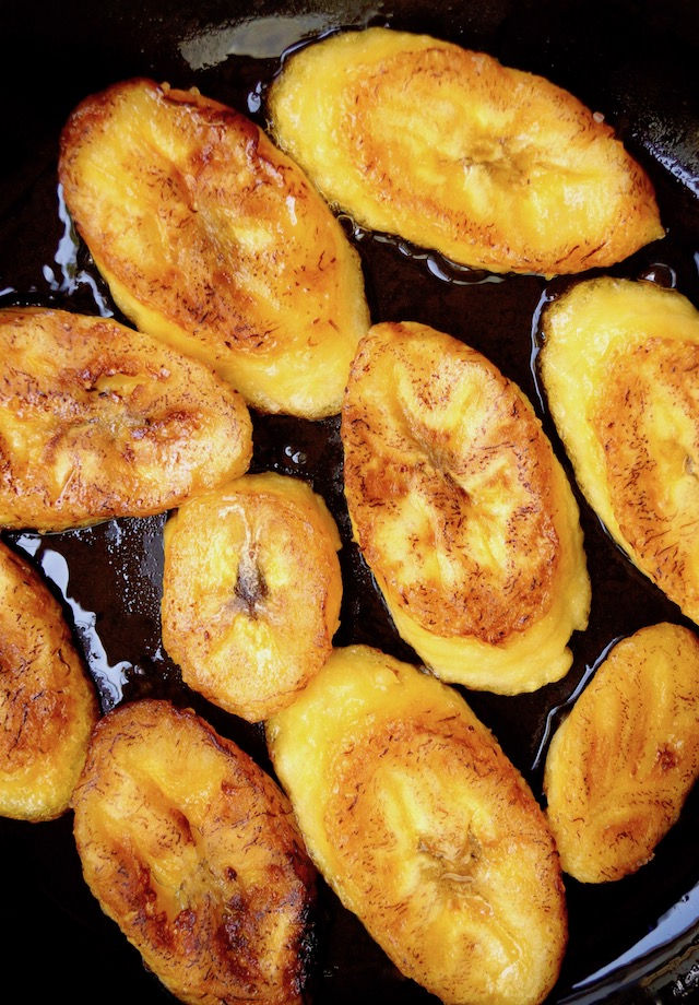 sliced fired plantains in skillet