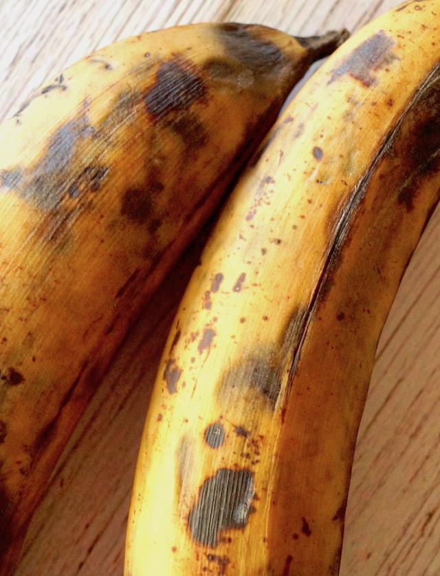 two plantains with black spots