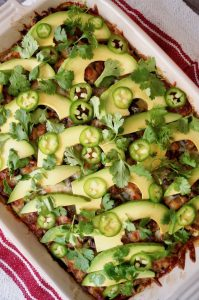 Grilled Zucchini Casserole with Mushrooms with sliced avocado on top