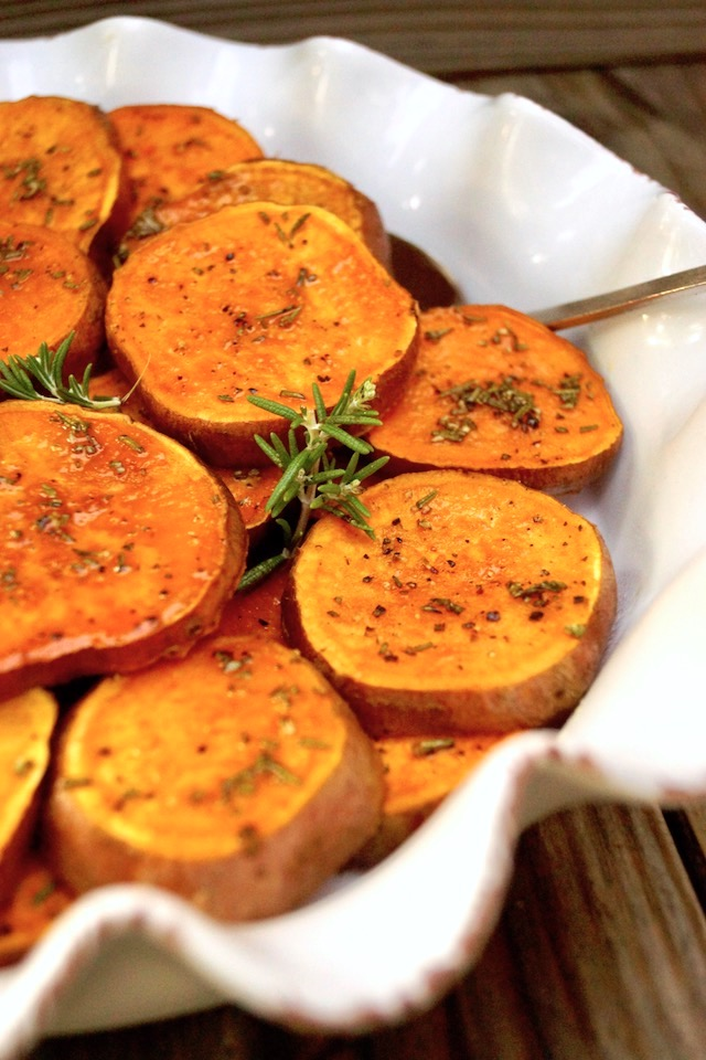 Baked Sliced Sweet Potatoes in a white pie dish
