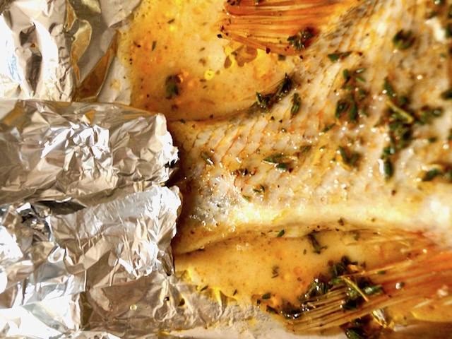 Baked Rockfish with tail wrapped in foil