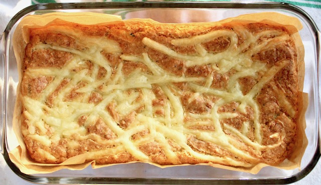 Baked Cauliflower Bread with Gruyère in glass baking dish