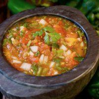 rosted poblano tomato salsa in black bowl