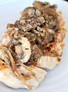 Chicken breast sliced with mushroom sauce on top