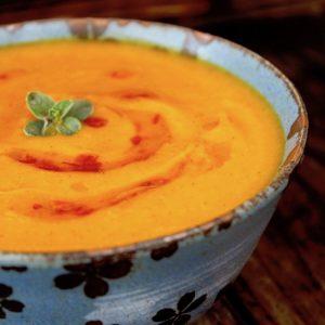 Red Kuri Squash soup in a blue bowl