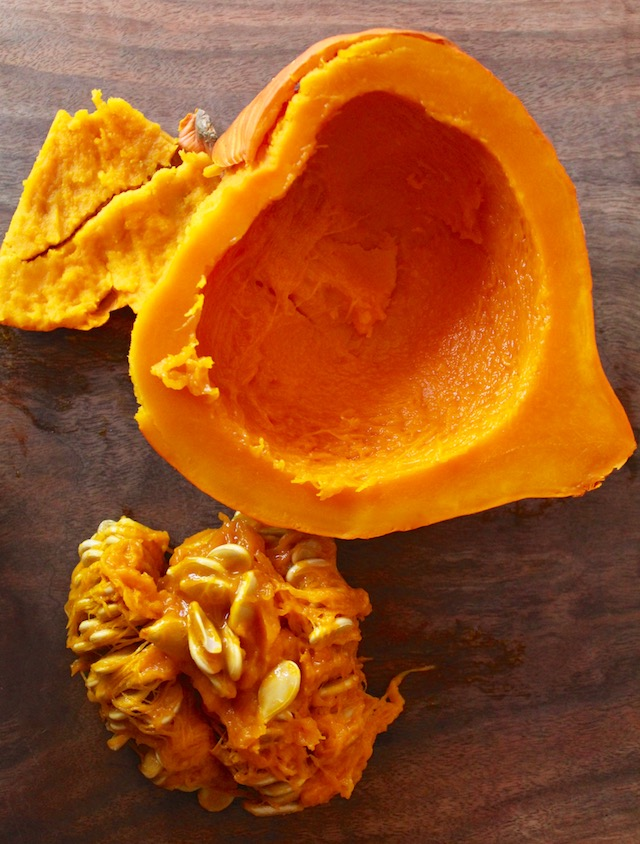 one half of Hokkaido pumpkin with seeds removed