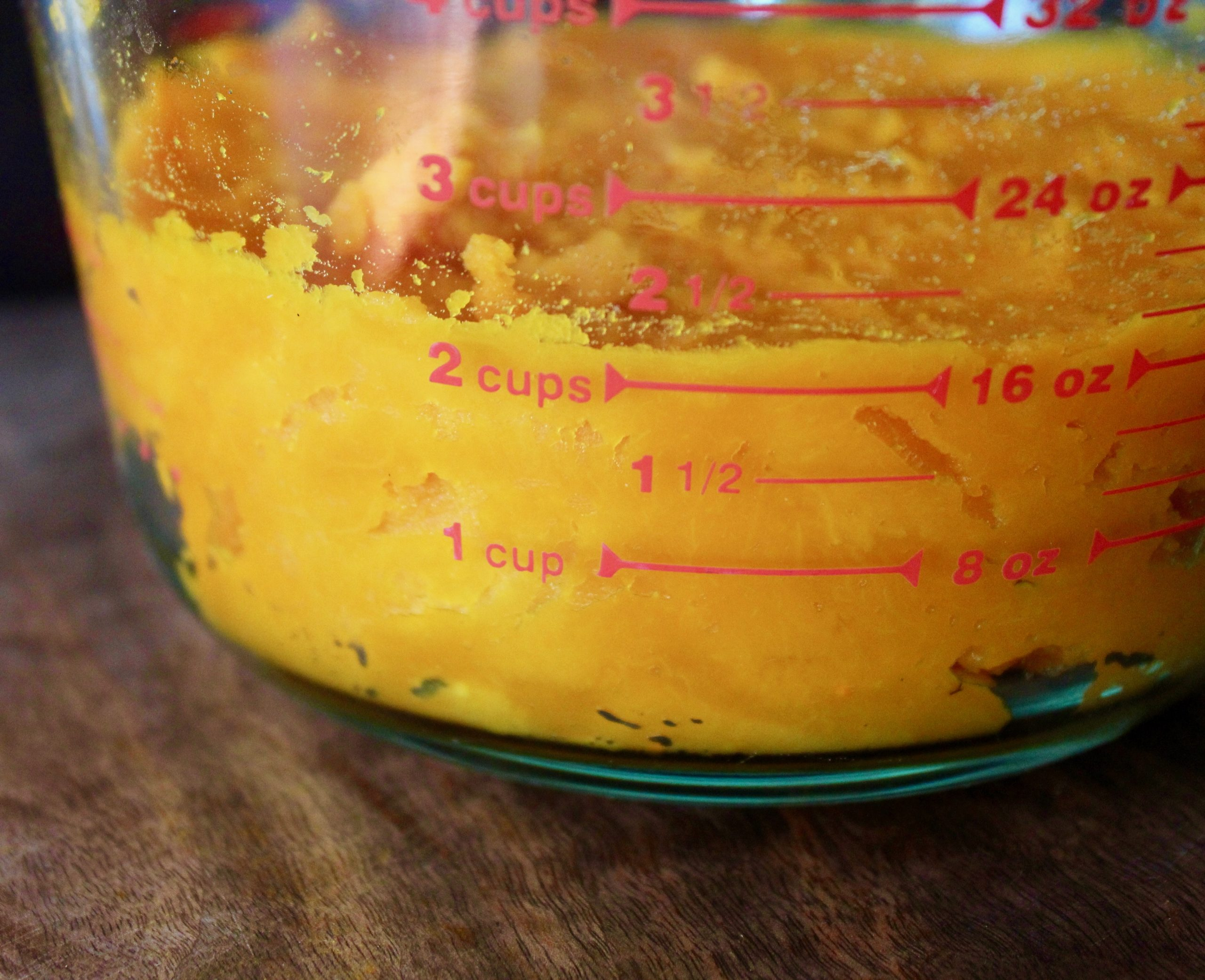 orange squash puree in measuing beaker