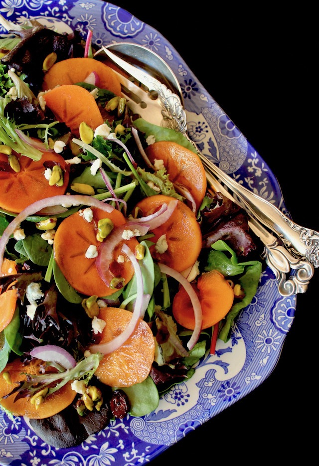Persimmon salad on blue and white china platter