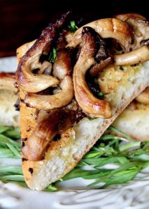 Oyster mushrooms with tarragon on triangle of bread