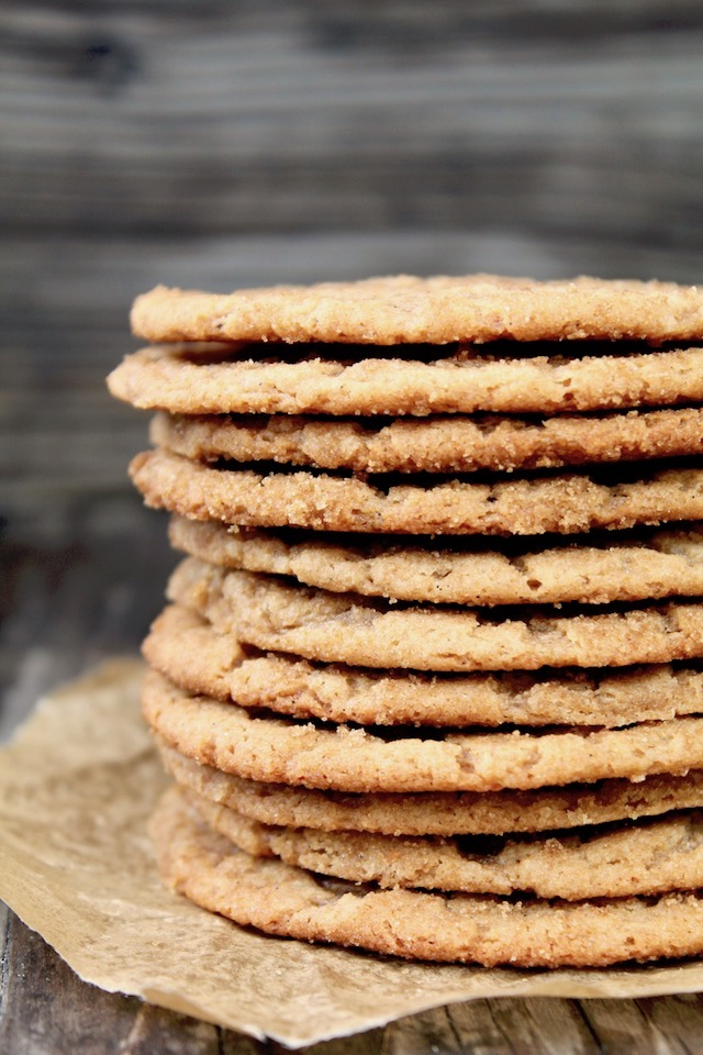 tall stack of thin miso cookies with peanut butter
