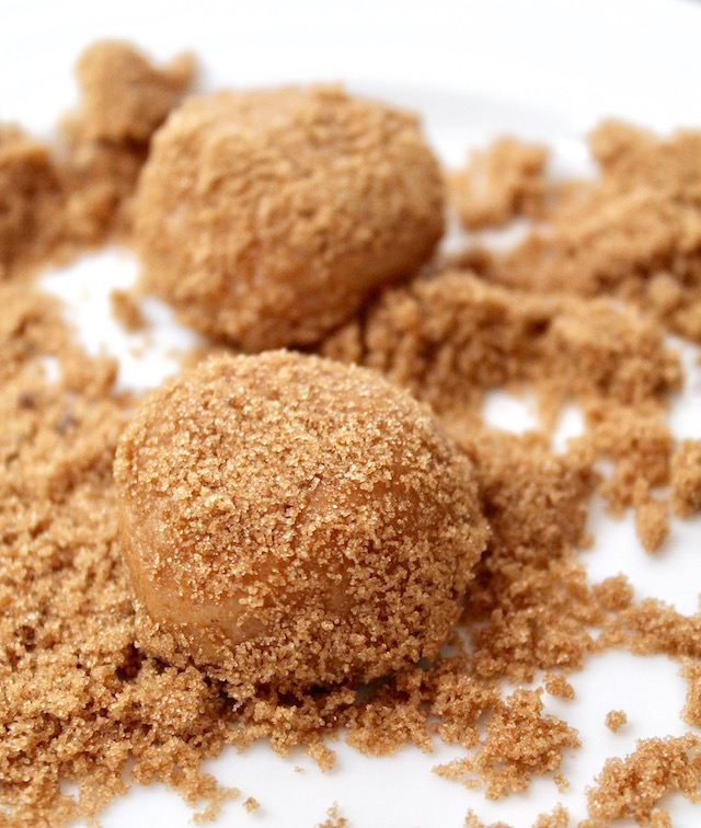 ball of miso cookie dough rolled in brown sugar