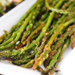 thin asparagus on white plate