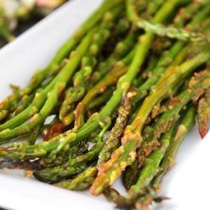 thin asparagus on white plate