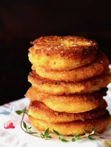 stack of hot water cornbread patties with fresh thyme