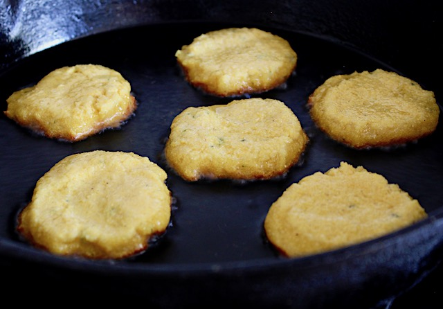 browning cornbread rounds in cast iron skillet