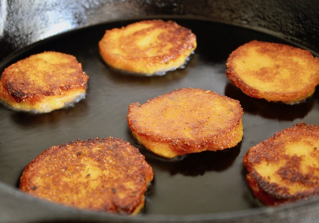 golden cornmeal patties in skillet