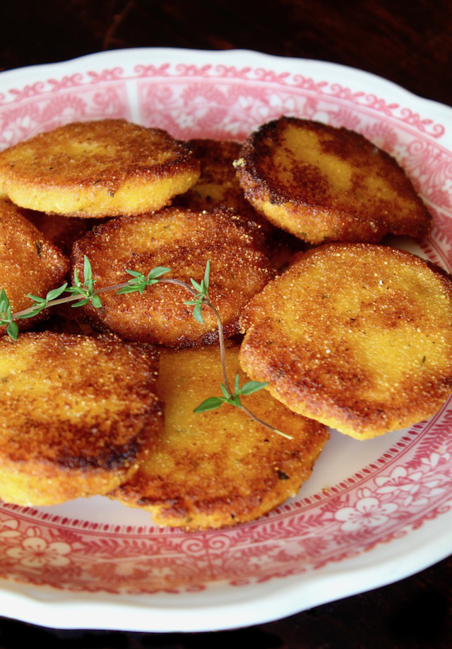 red-rimmed plate with several golden brown hot water cornbread patties