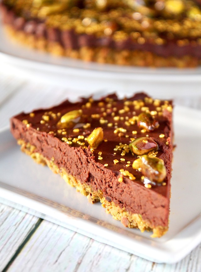 slice of chocolate tart on a square white plate