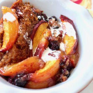 white bowl with peach cobber (gluten-free)